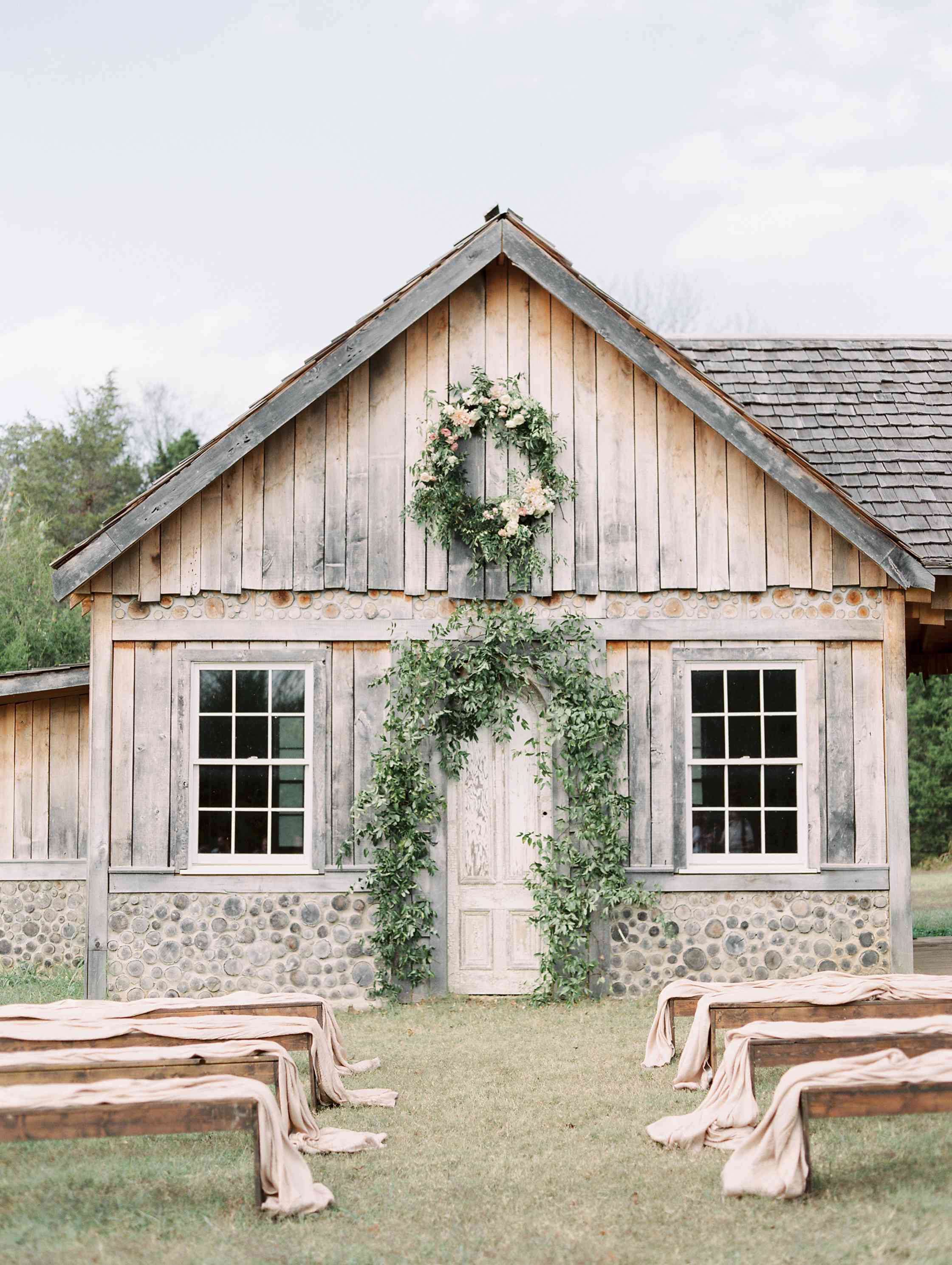 Wedding ceremony with rustic wood and greenery