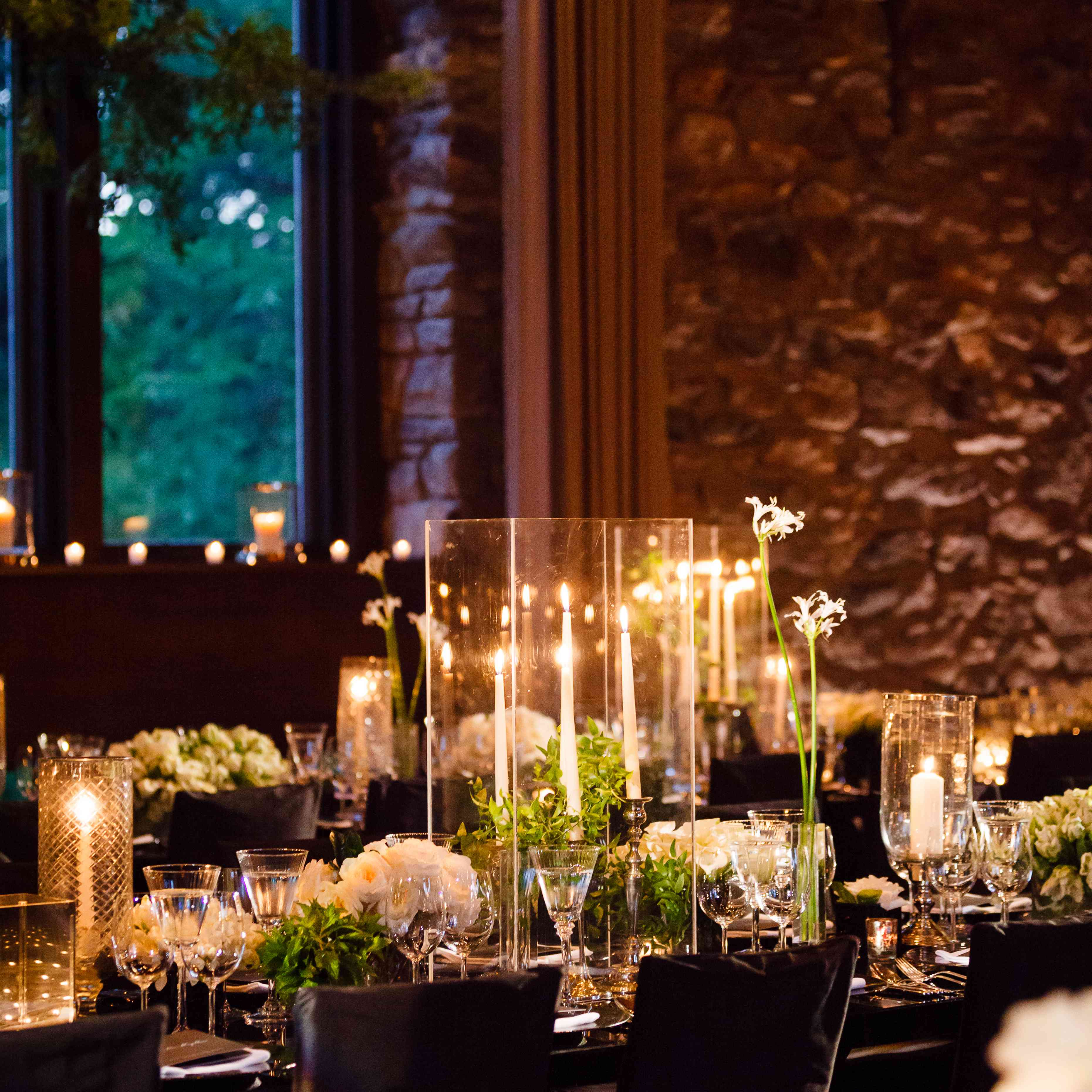 candle and floral centerpieces black chairs