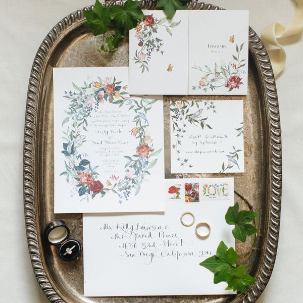invitation suite flat lay on a metal tray with ivy