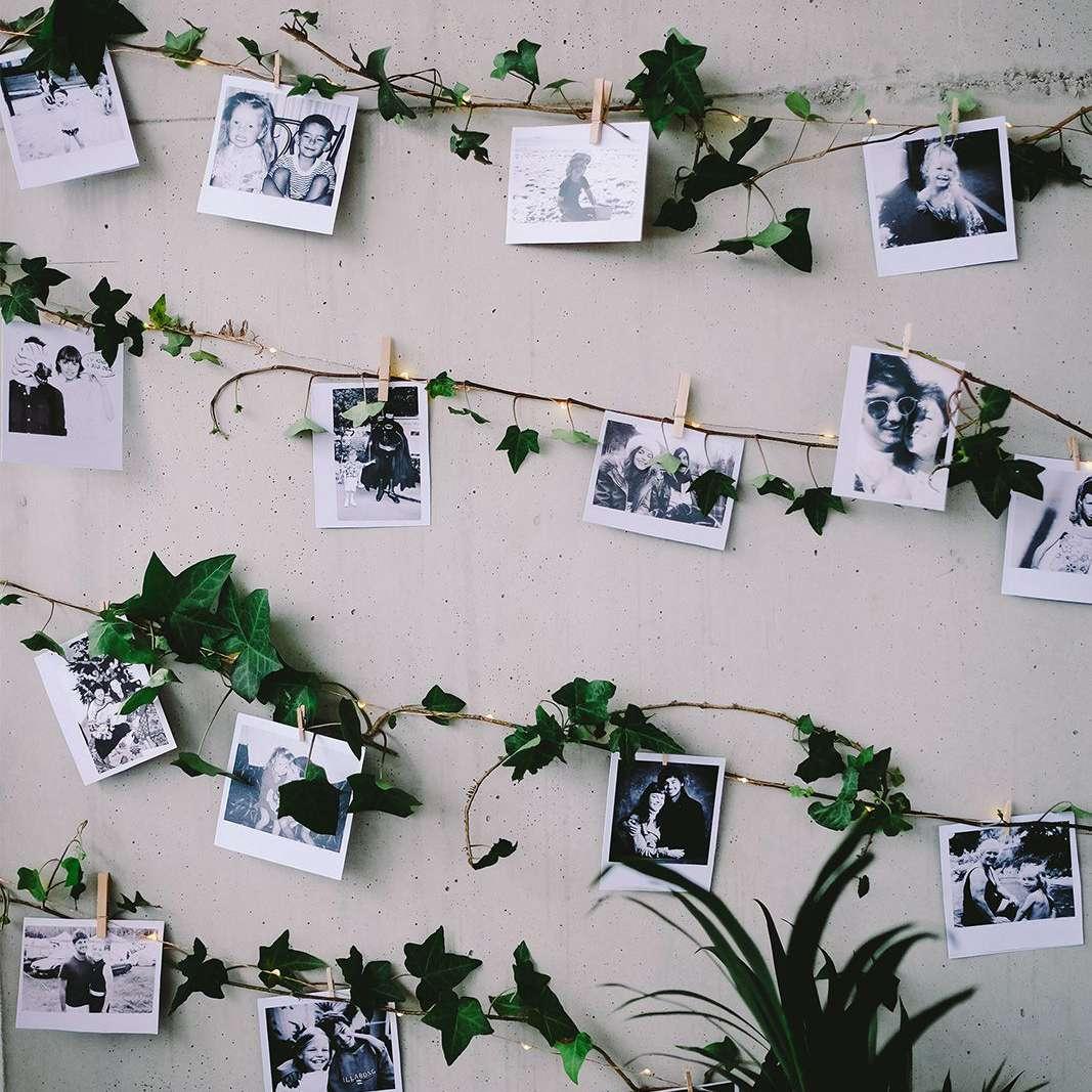 Photo wall of newlyweds as children