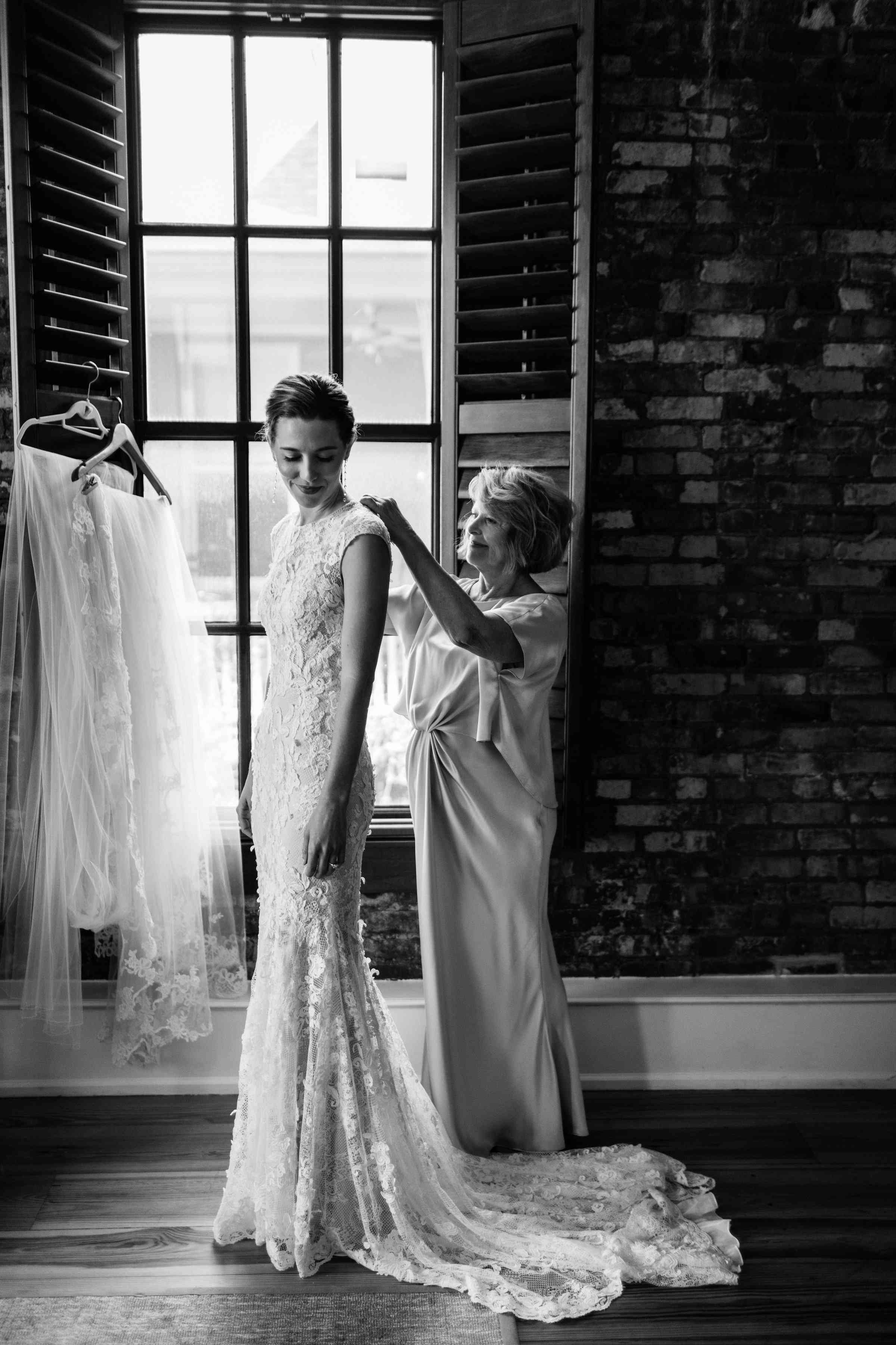 Bride getting ready with mother of bride