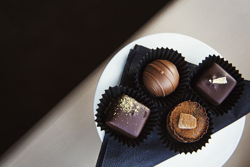 Assorted hand made chocolates on a plate