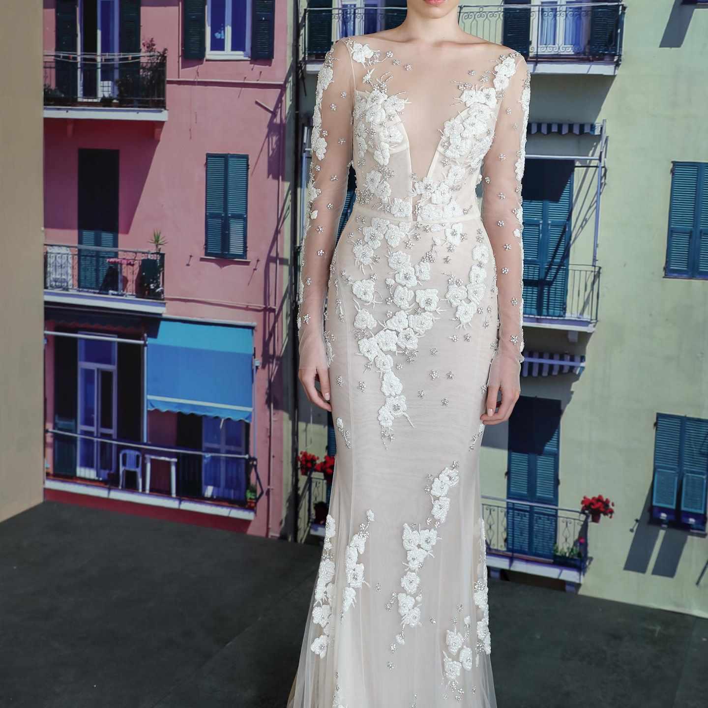 Model in floral embellished wedding gown