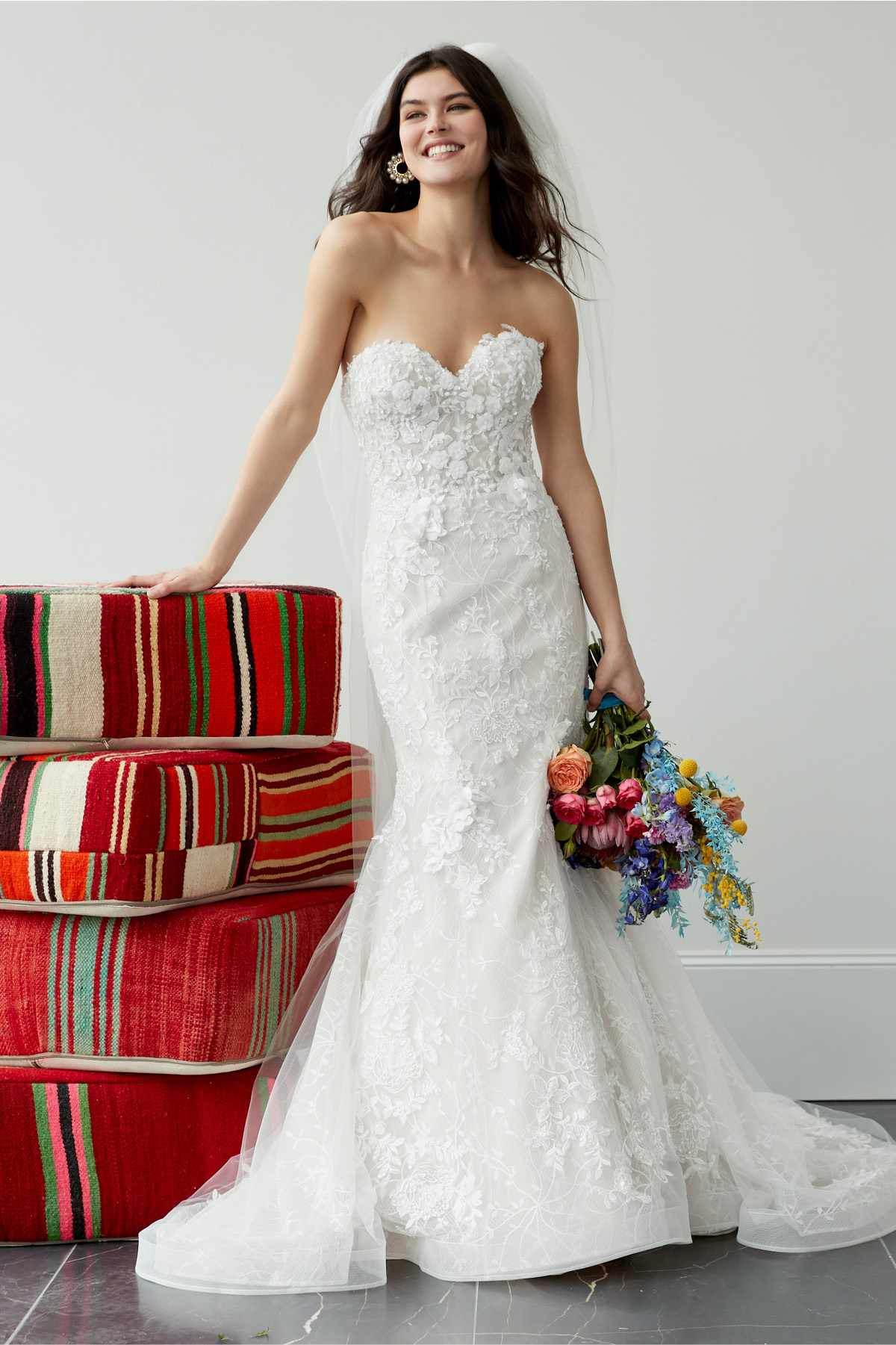 Model in strapless sweetheart lace fit-and-flare with 3D floral motifs