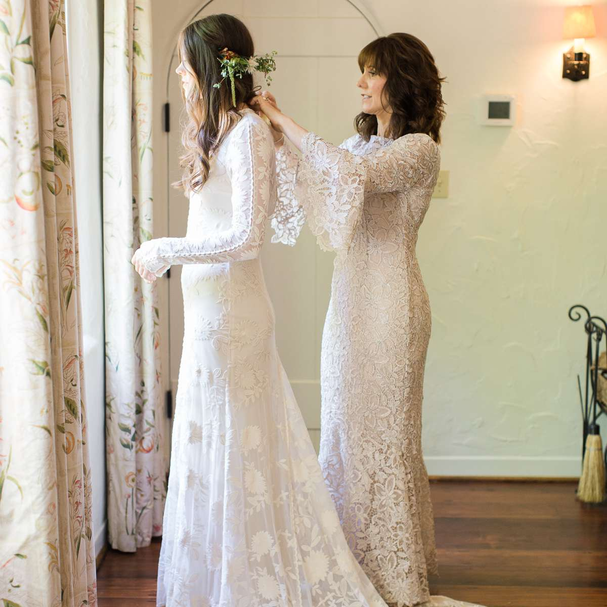 Bride getting ready with mother of the bride