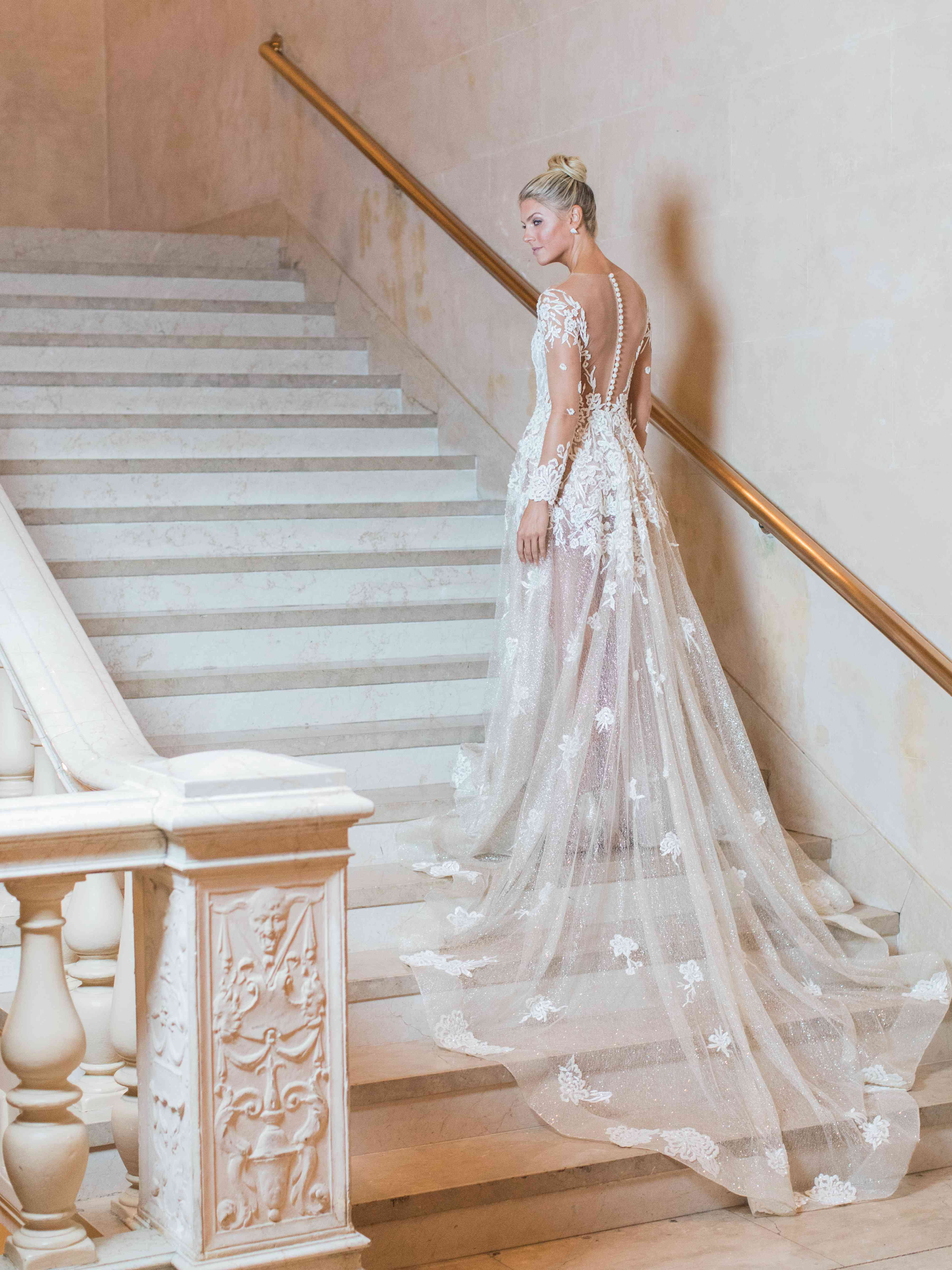 Bride with train on stairs
