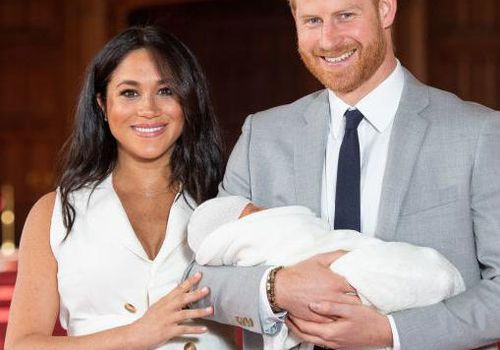 Duke of Sussex and Meghan, Duchess of Sussex, pose with their newborn son.