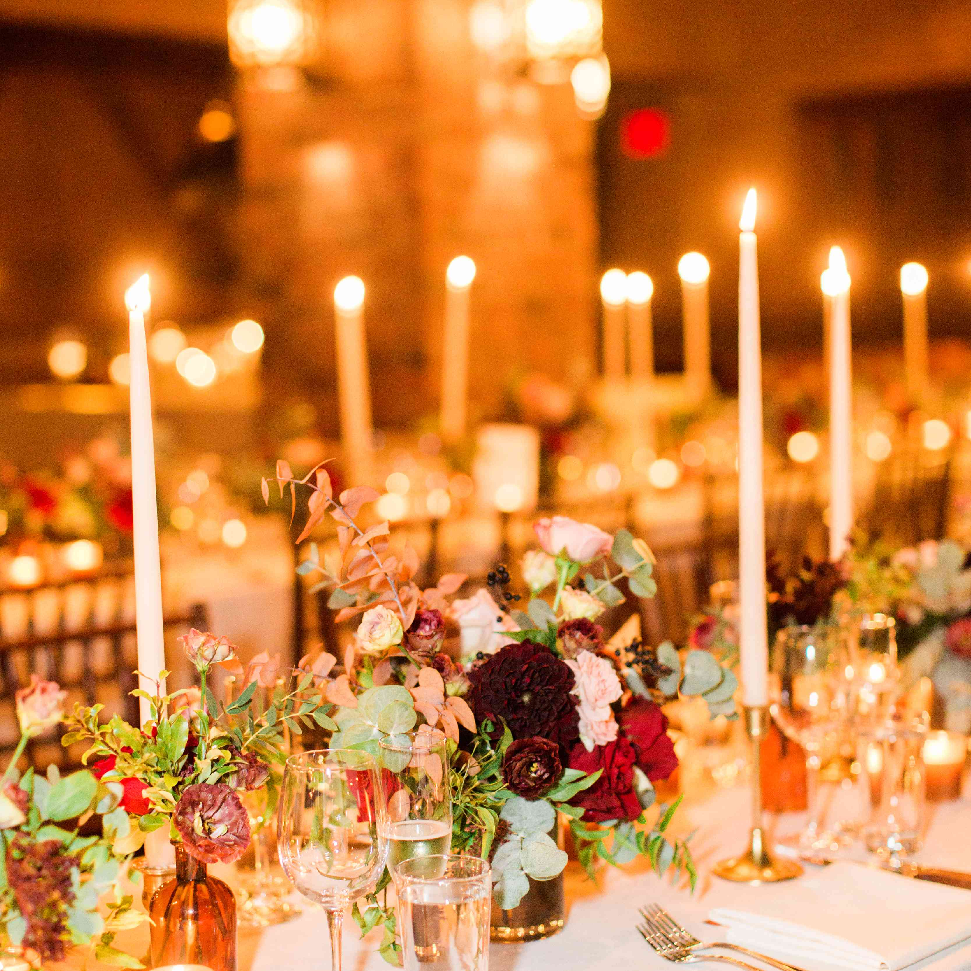 candlelit reception long community tables