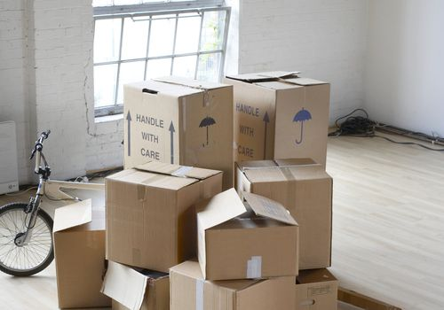 Stack of boxes in middle of room