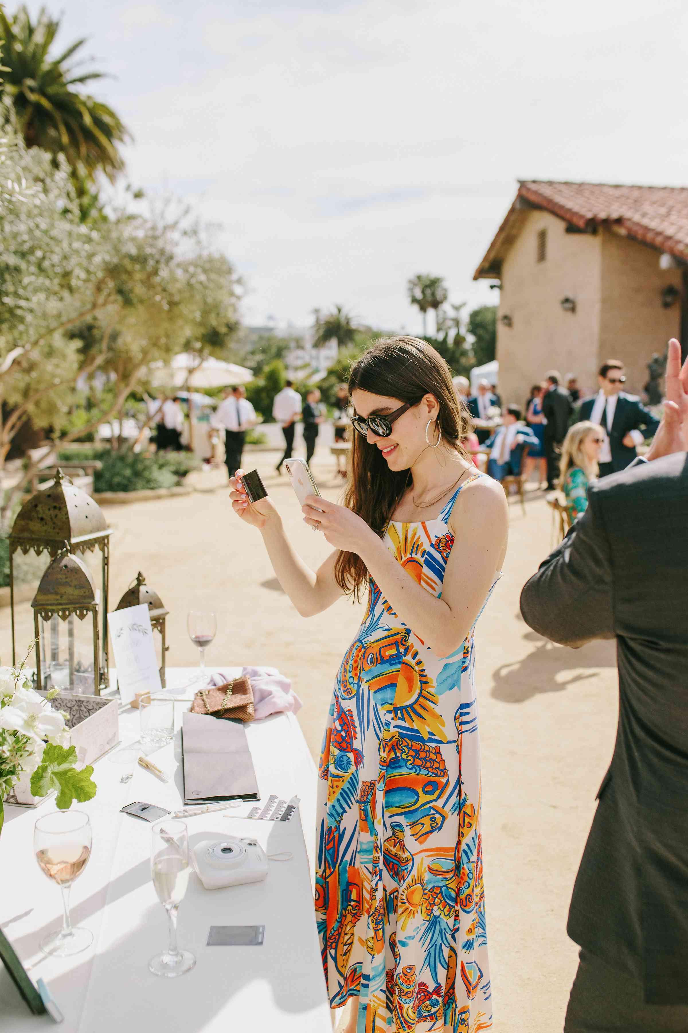<p>guests taking polaroids</p><br><br>