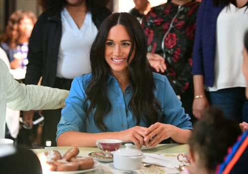 Meghan Markle sits during her royal visit to South Africa.