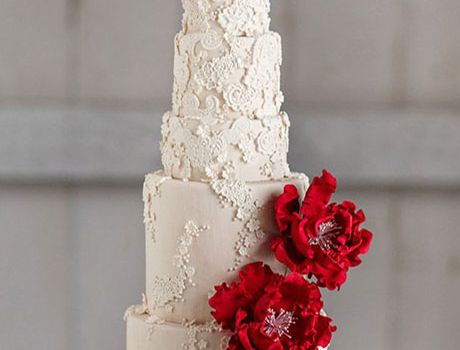 lace wedding cake with red flowers