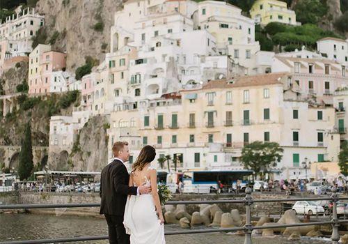 Couple walking by waterfront on Amalfi Coast