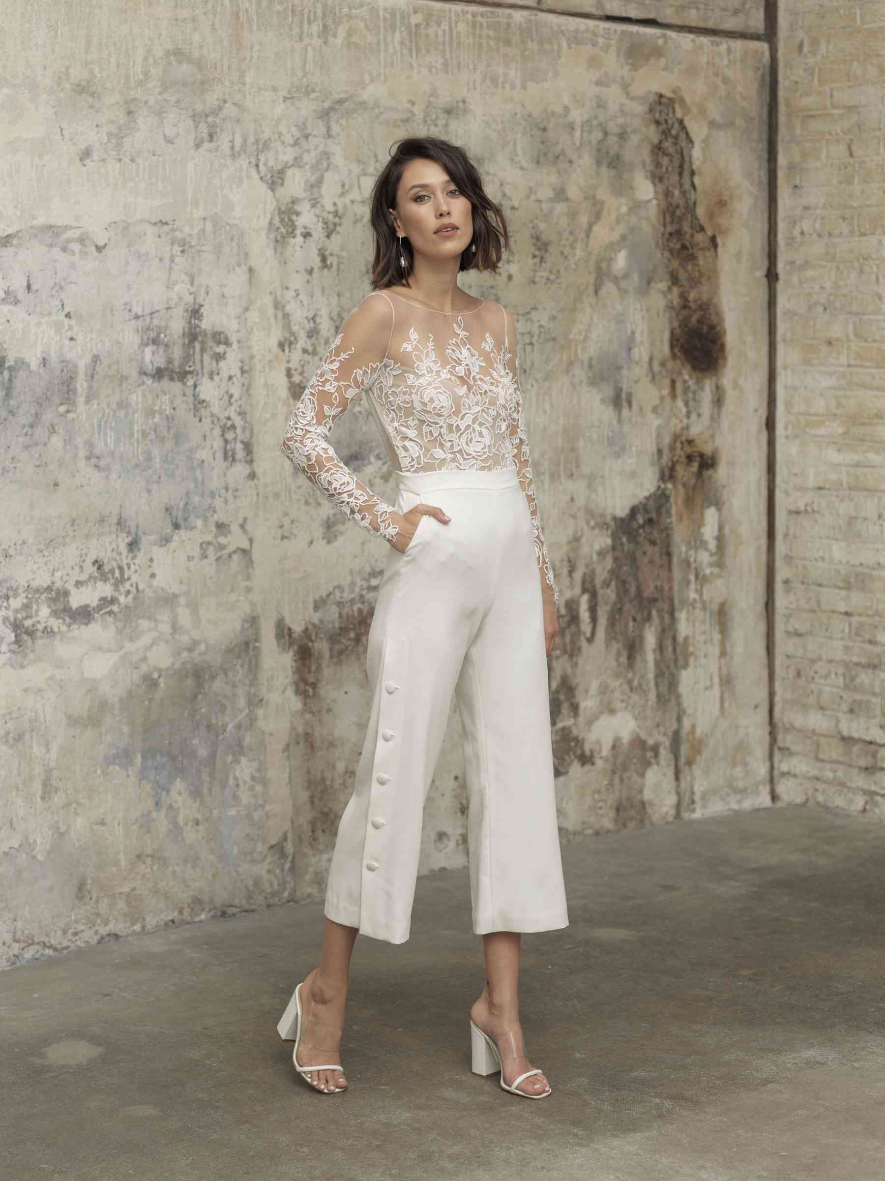 Model in white jumpsuit with lace top and pockets