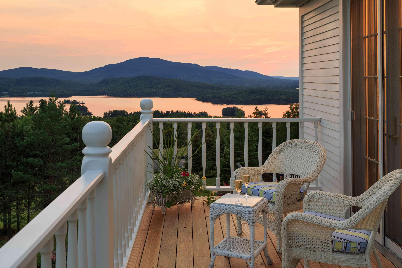 balcony overlooking sunset-lit lake