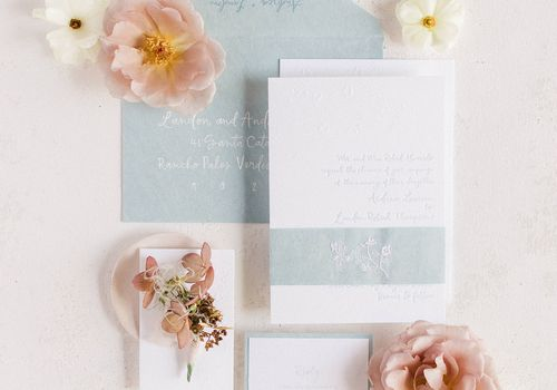 invitation suite flat lay with flowers