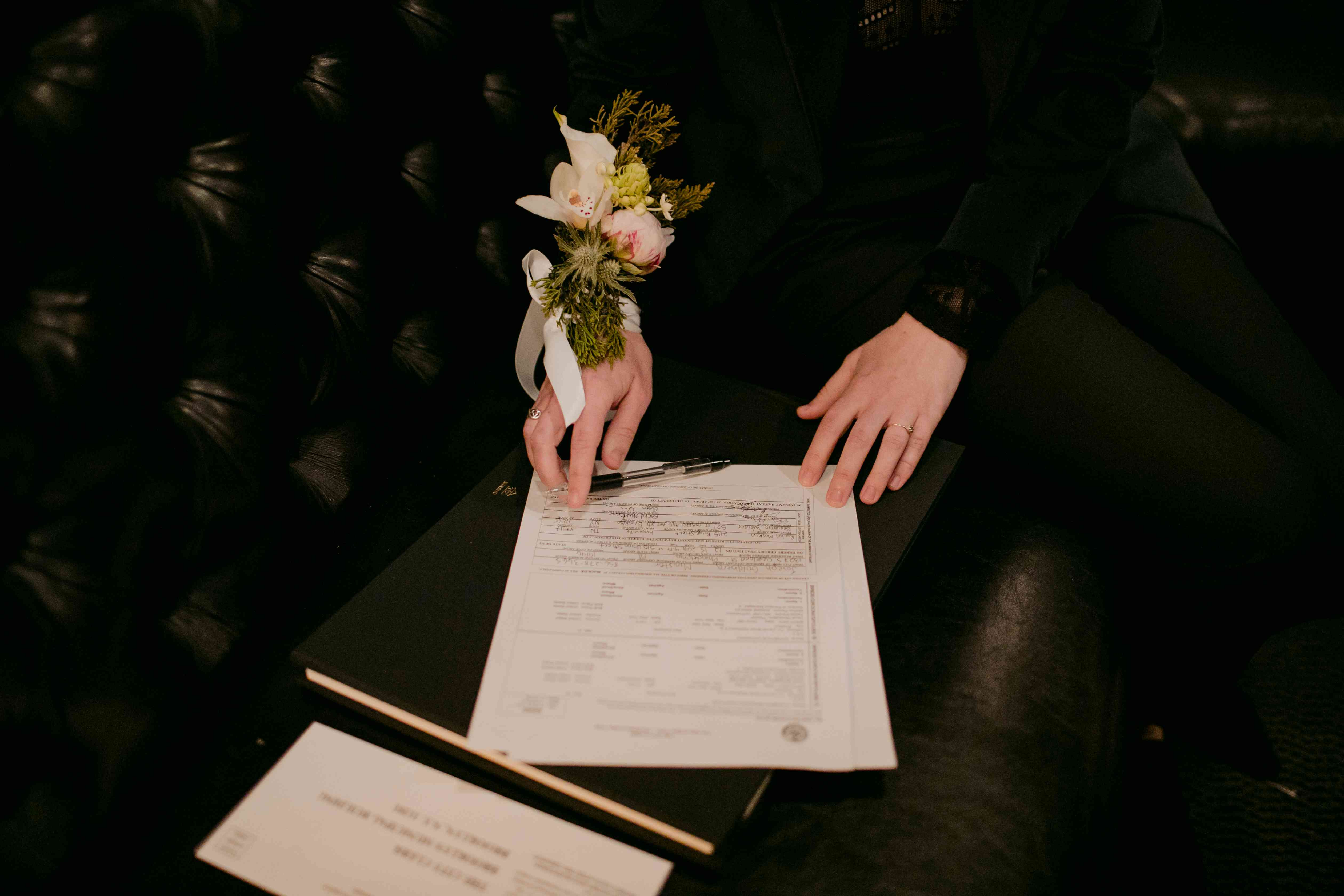 Katie signs her marriage document