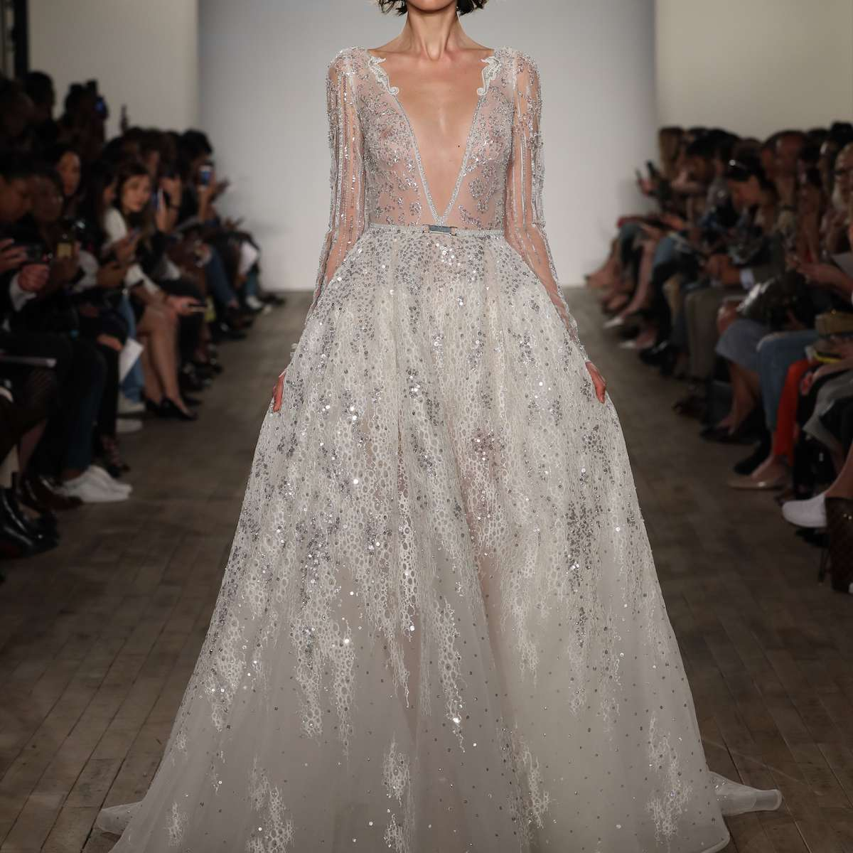 Model in plunging long sleeve wedding ball gown
