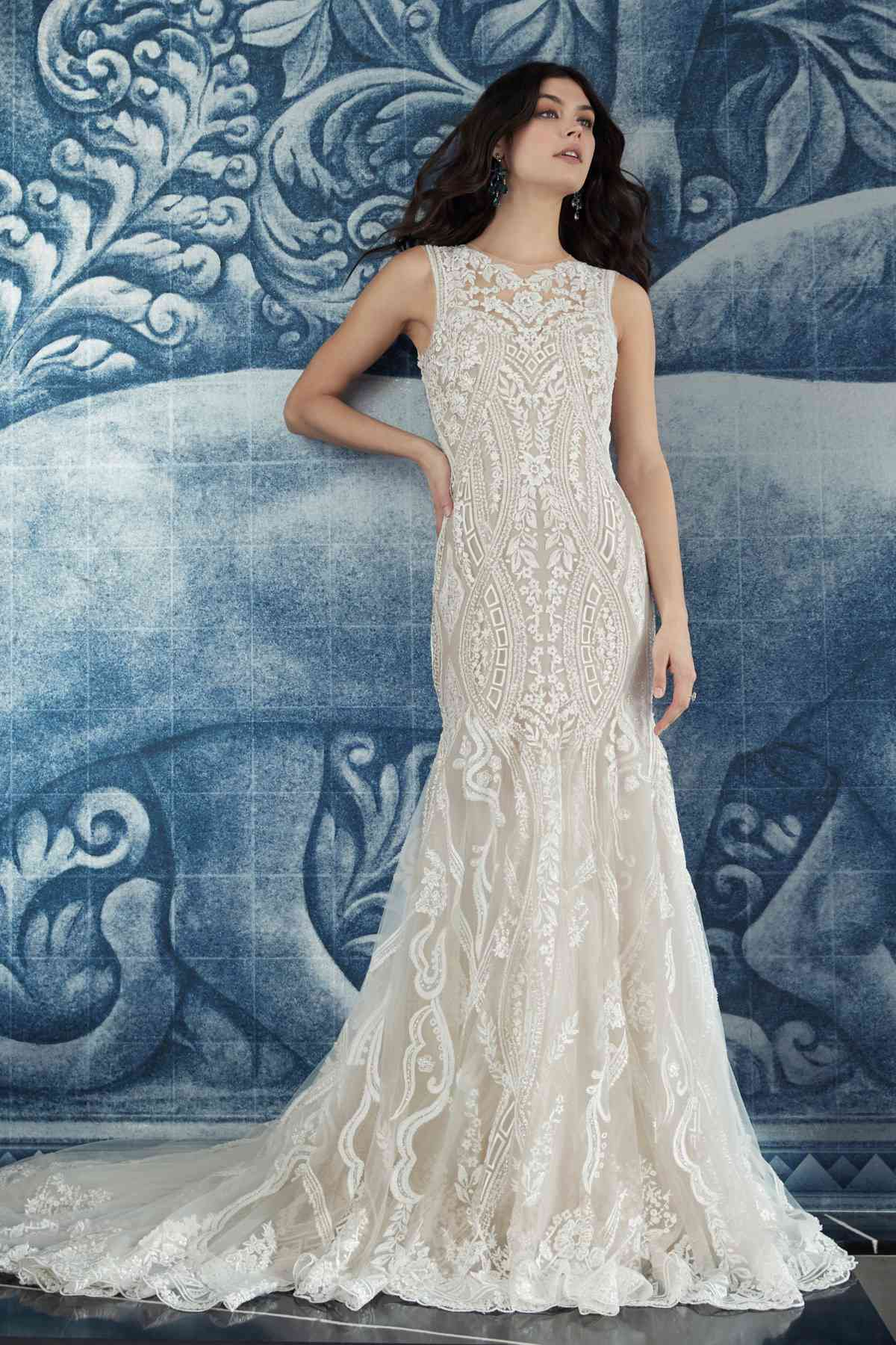 Model in allover lace fit-and-flare gown with a jeweled high neckline