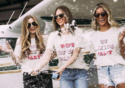 girls popping champagne