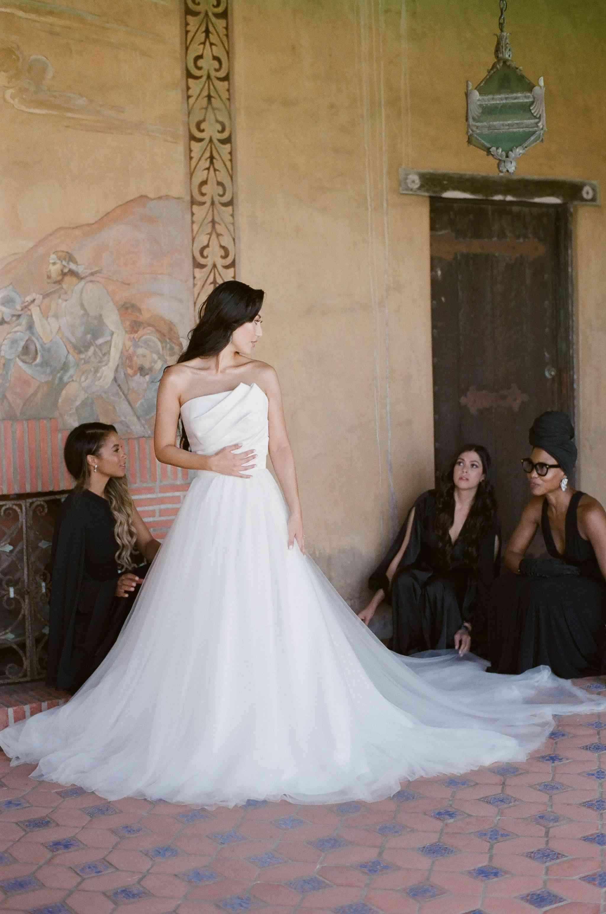 Bridesmaids helping bride get ready