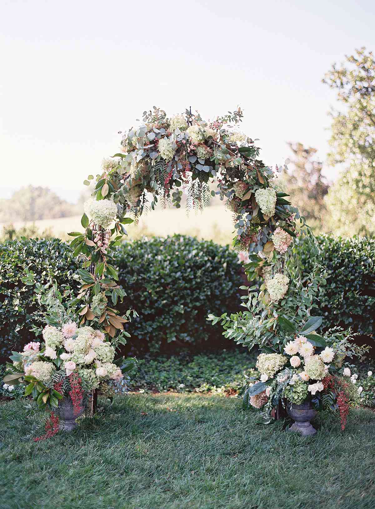 An arch made with hydrangea and magnolia flowers