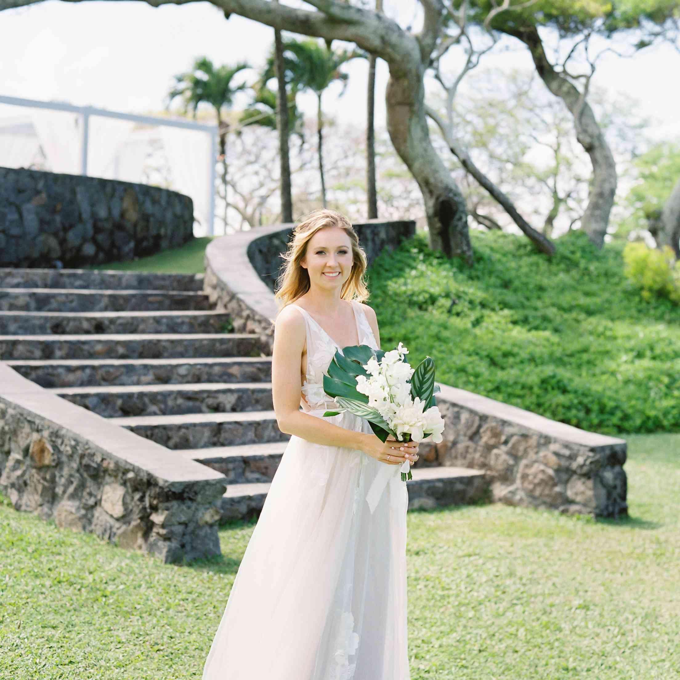 tropical maui wedding, bride wedding dress tropical bouquet