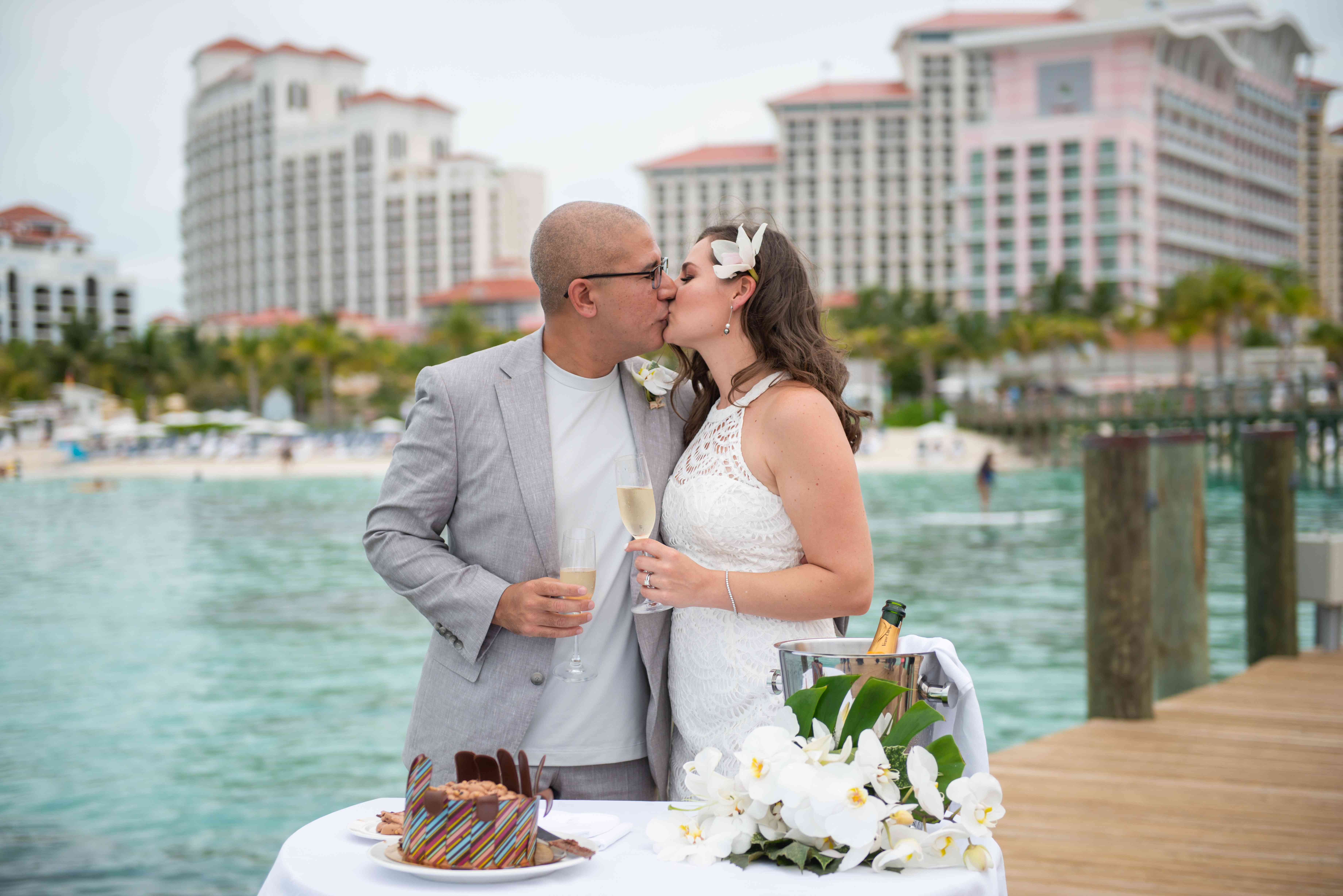couple kissing with cake