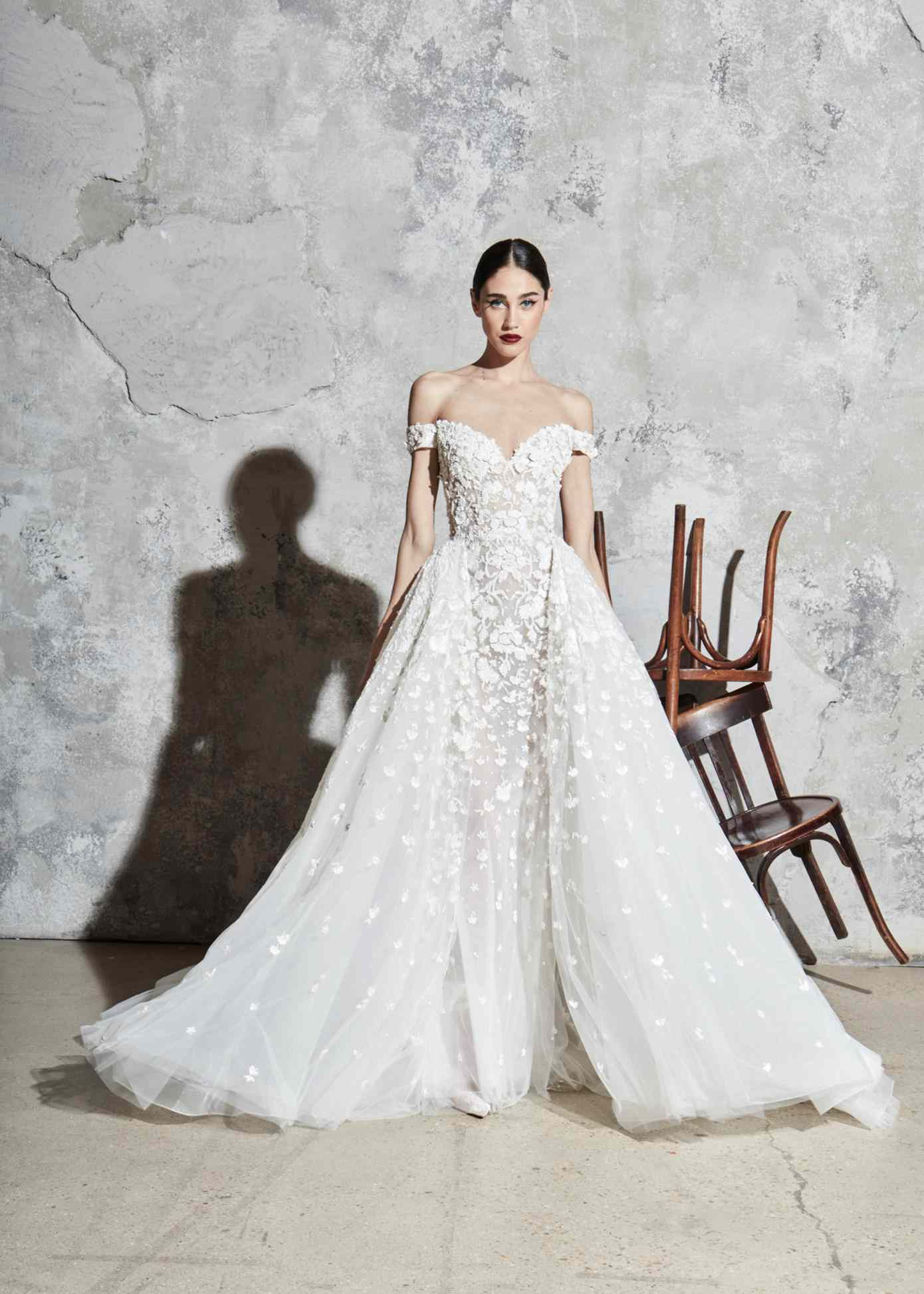 Model in off-the-shoulder tulle ballgown with a sweetheart neckline, floral embroidery and appliques