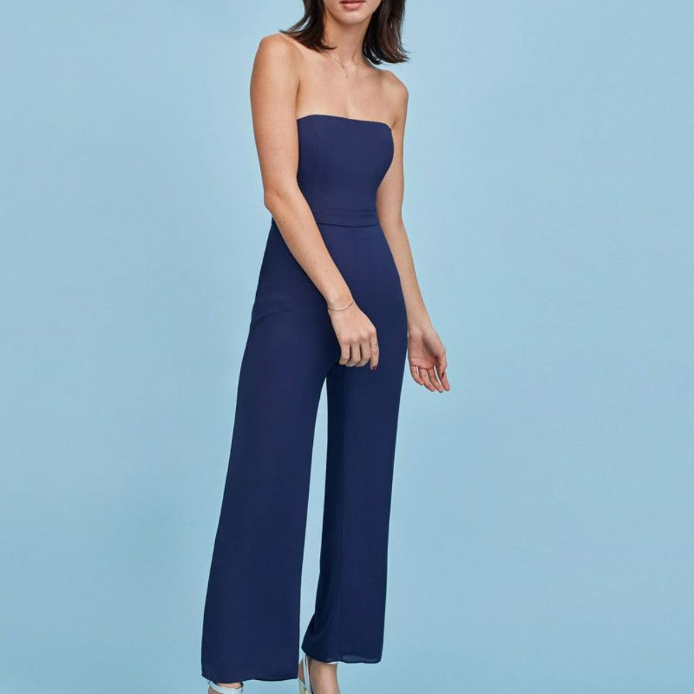 Model in a strapless royal blue jumpsuit