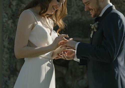 <p>exchanging rings putting on wedding bands</p>