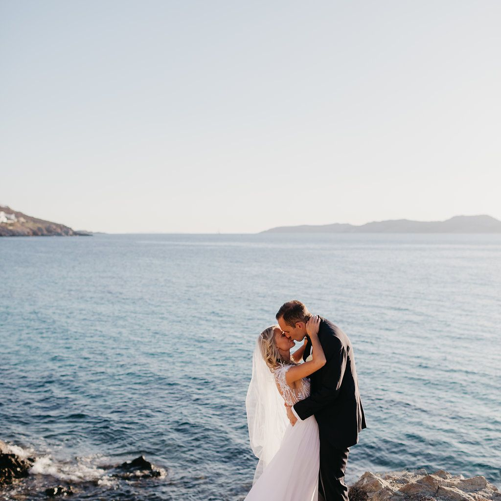 bride and groom kissing beach wedding