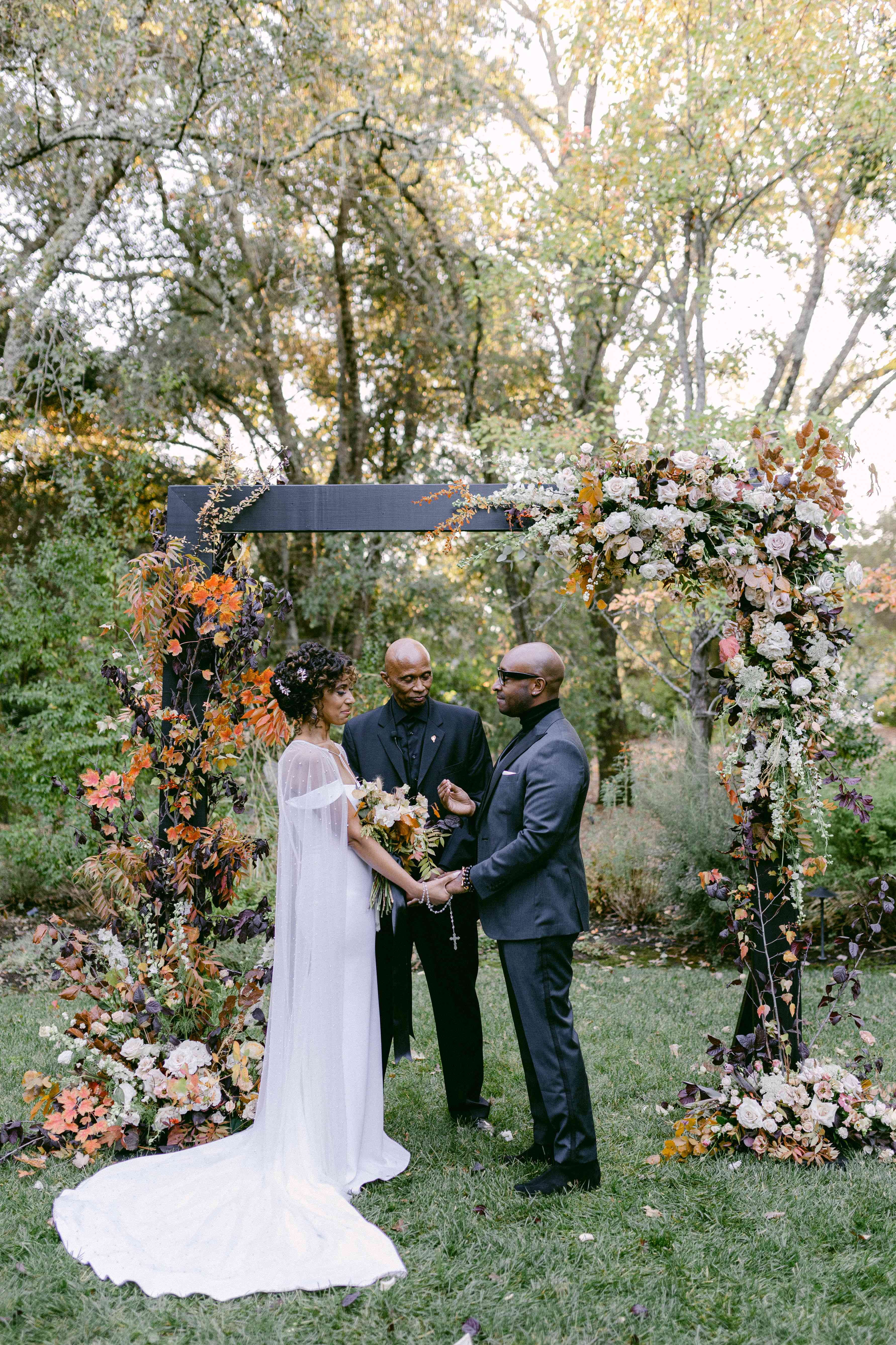 bride and groom with officiant
