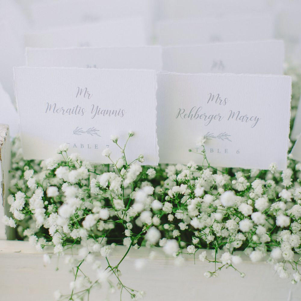 escort card display with baby's breath