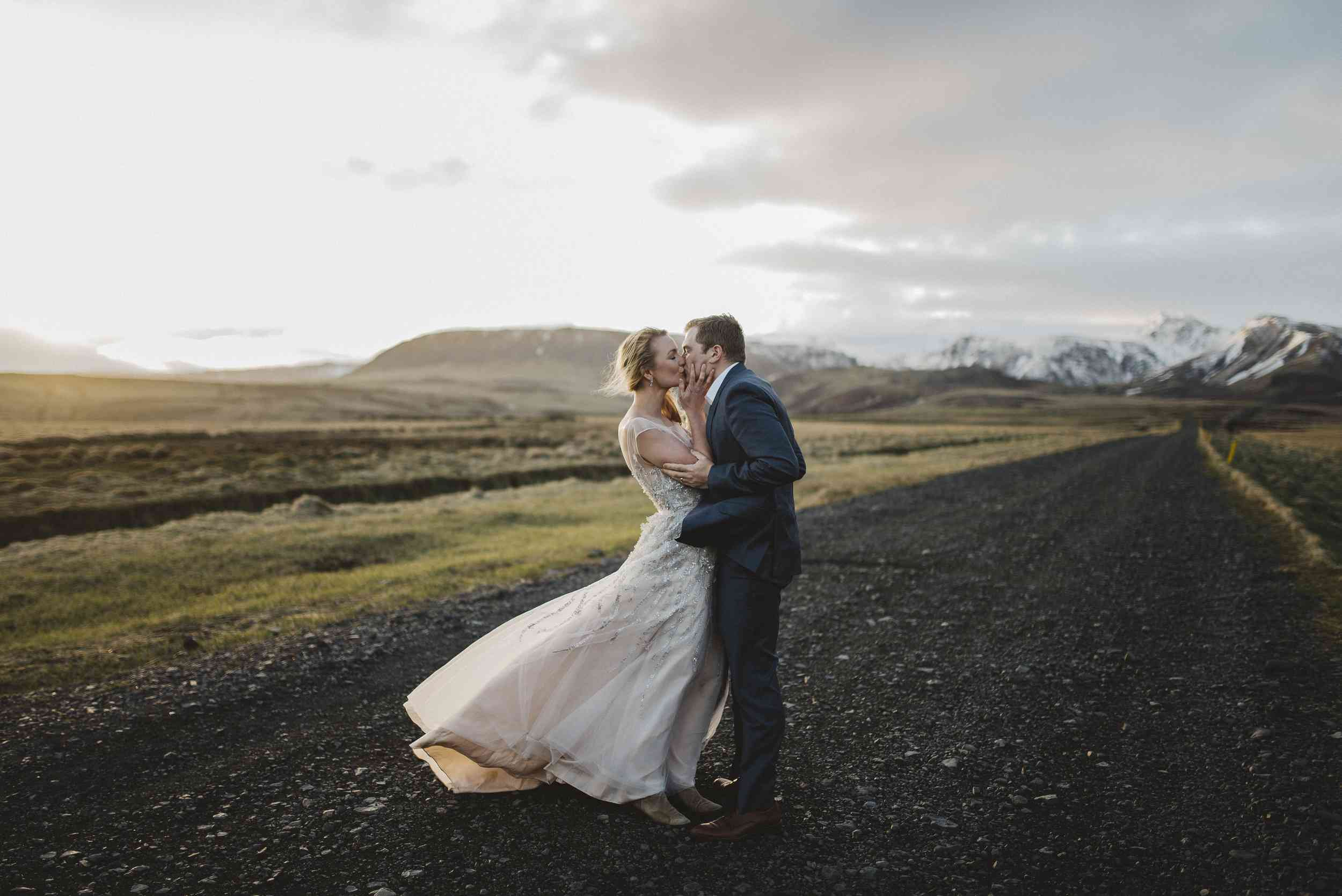 Couple kissing on a road in Iceland