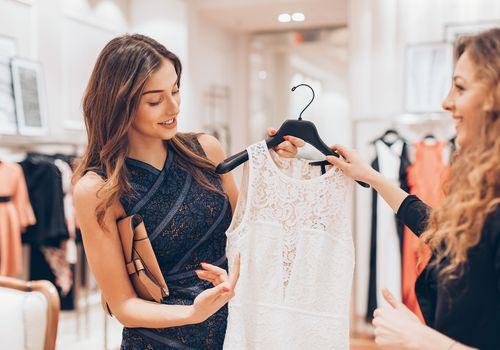 Girls shopping for dresses