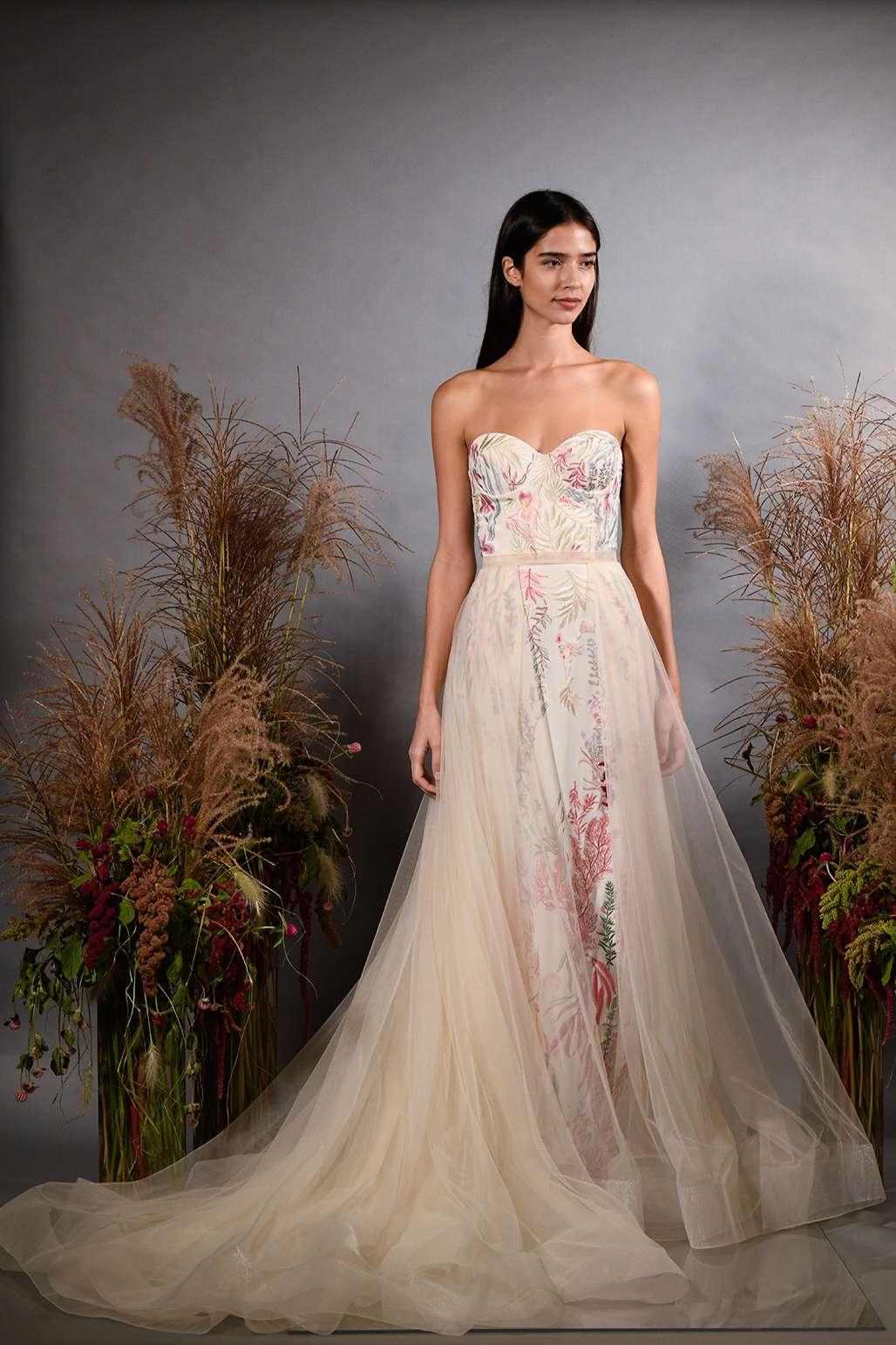 Model in strapless sweetheart wedding dress with overskirt