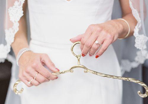 bride holding hanger