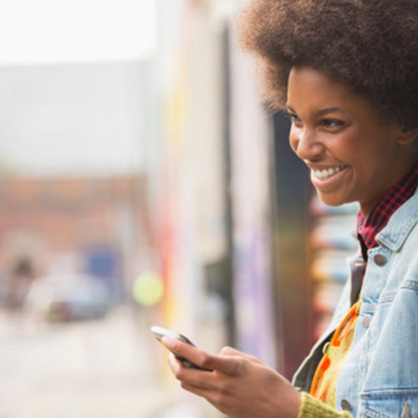 Woman smiling at phone.