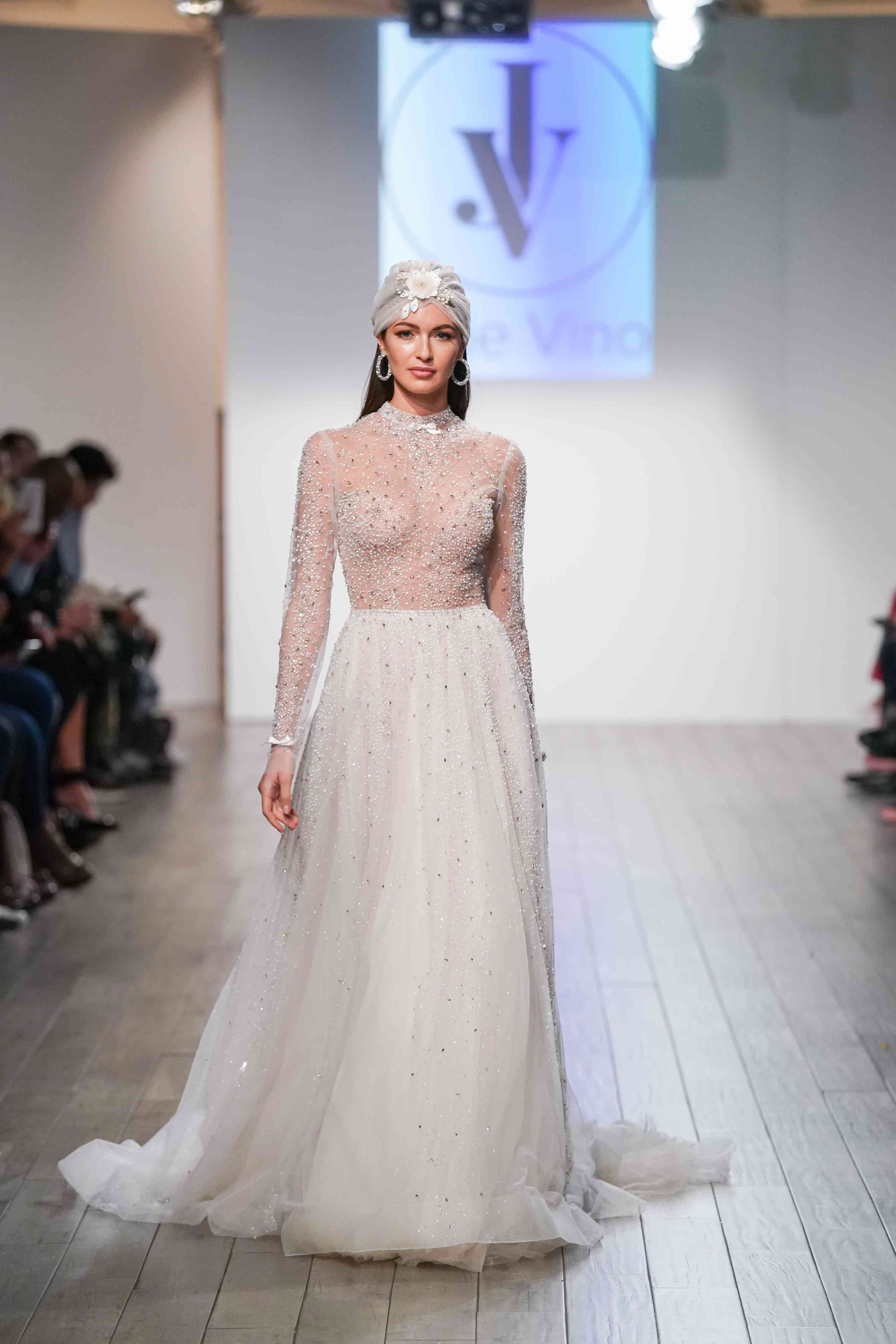 Model in high neck long sleeve wedding dress