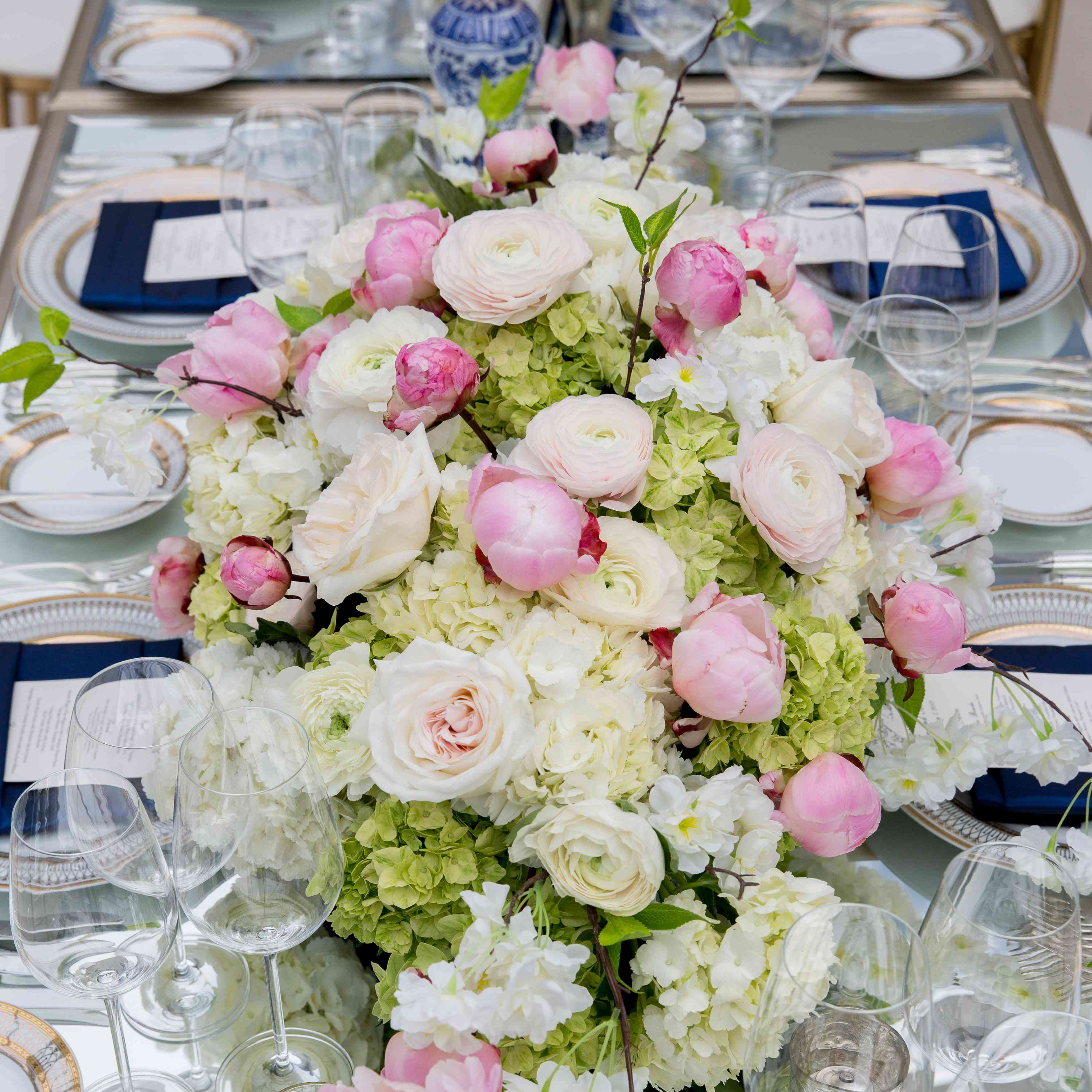 <p>Centerpiece with Green Hydrangeas and Blush Peonies</p><br><br>