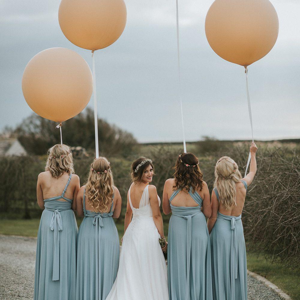 bridesmaids holding balloons