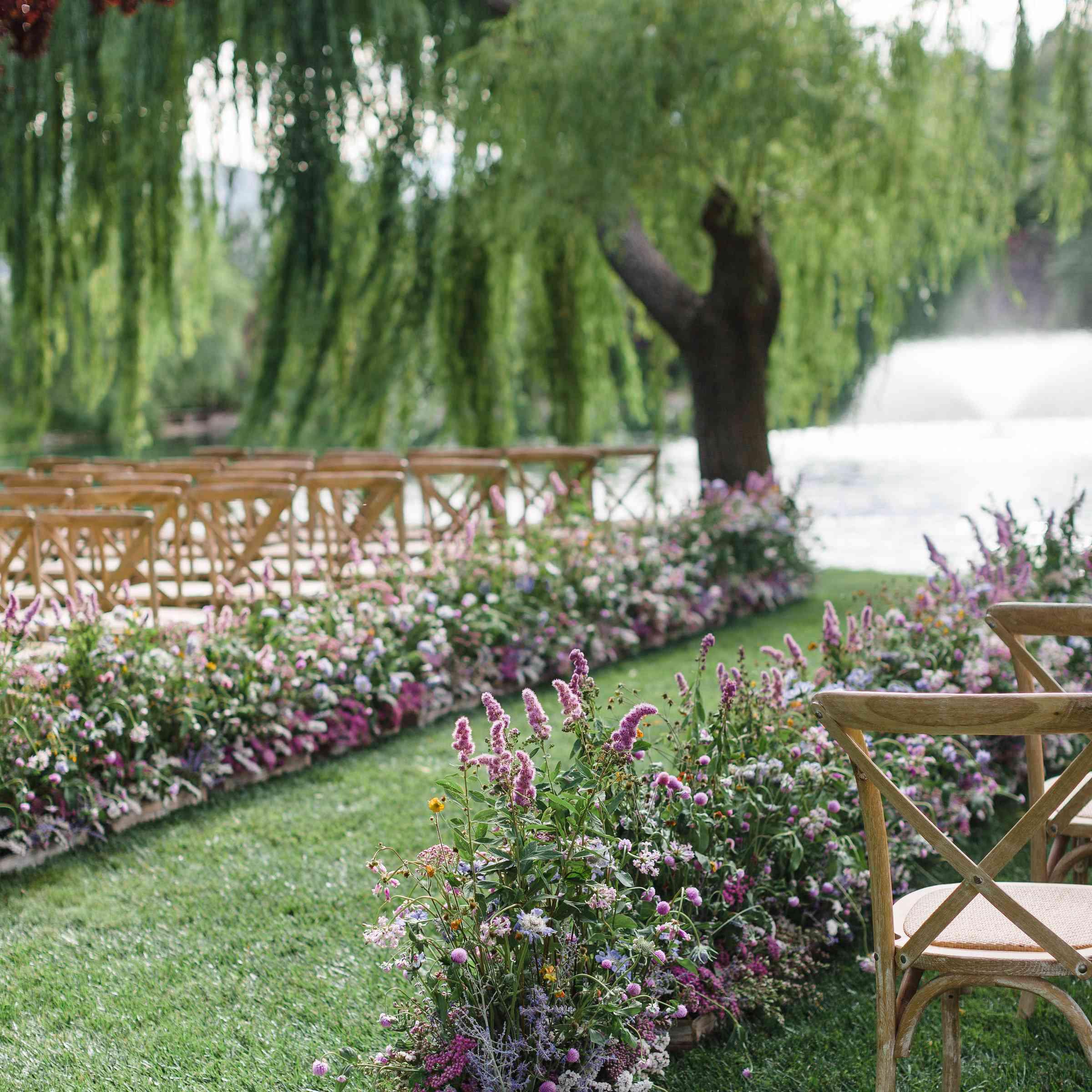 pink and purple wedding aisle flowers