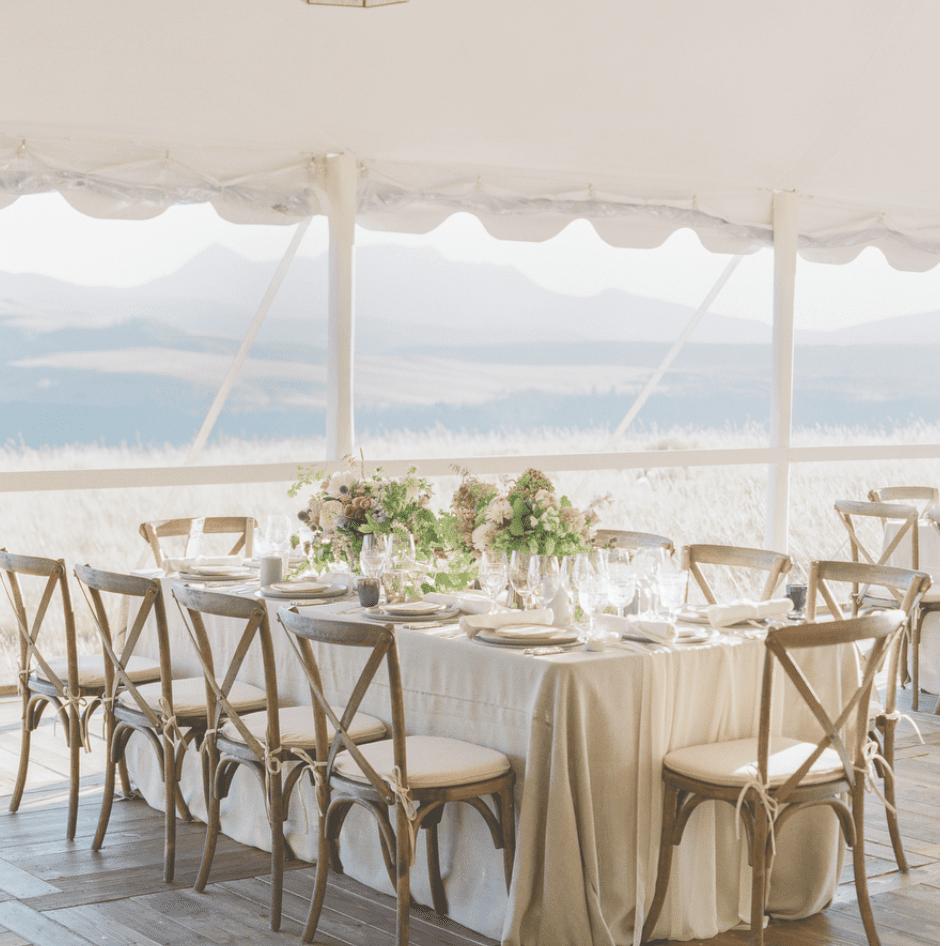 Neutral beige reception set-up inside tent