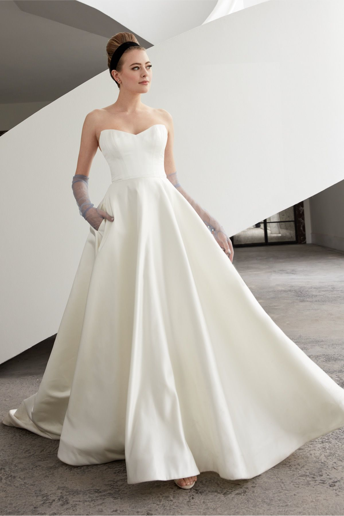 Model in strapless ball gown wedding dress with pockets