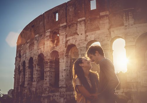Couple in front of Roman Colosseum