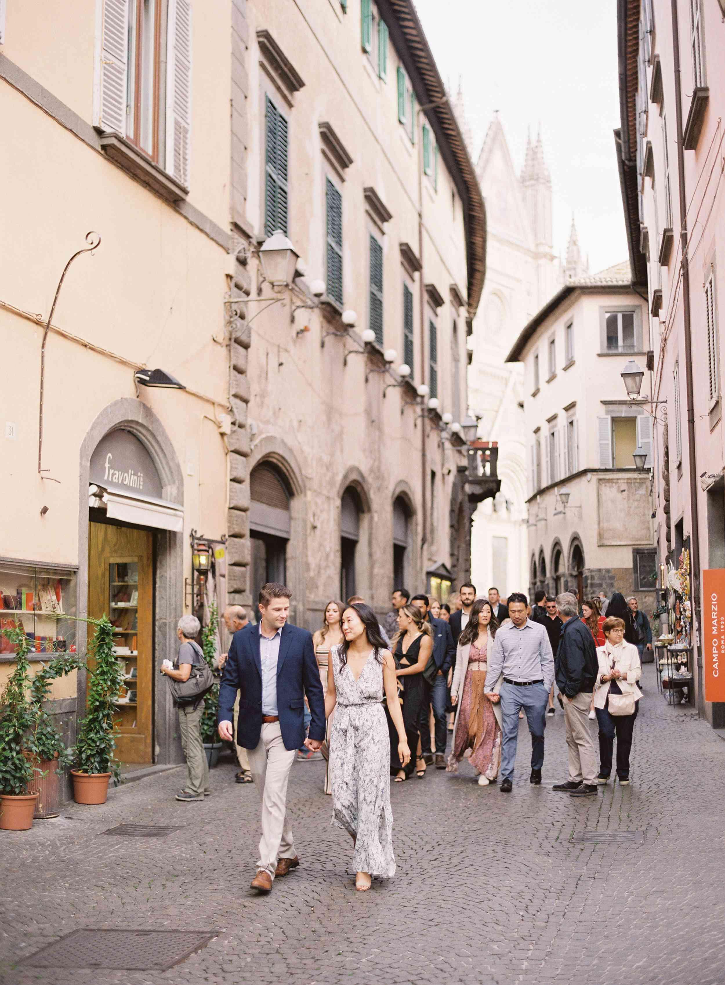 classic la badia italian wedding, bride and groom holding hands