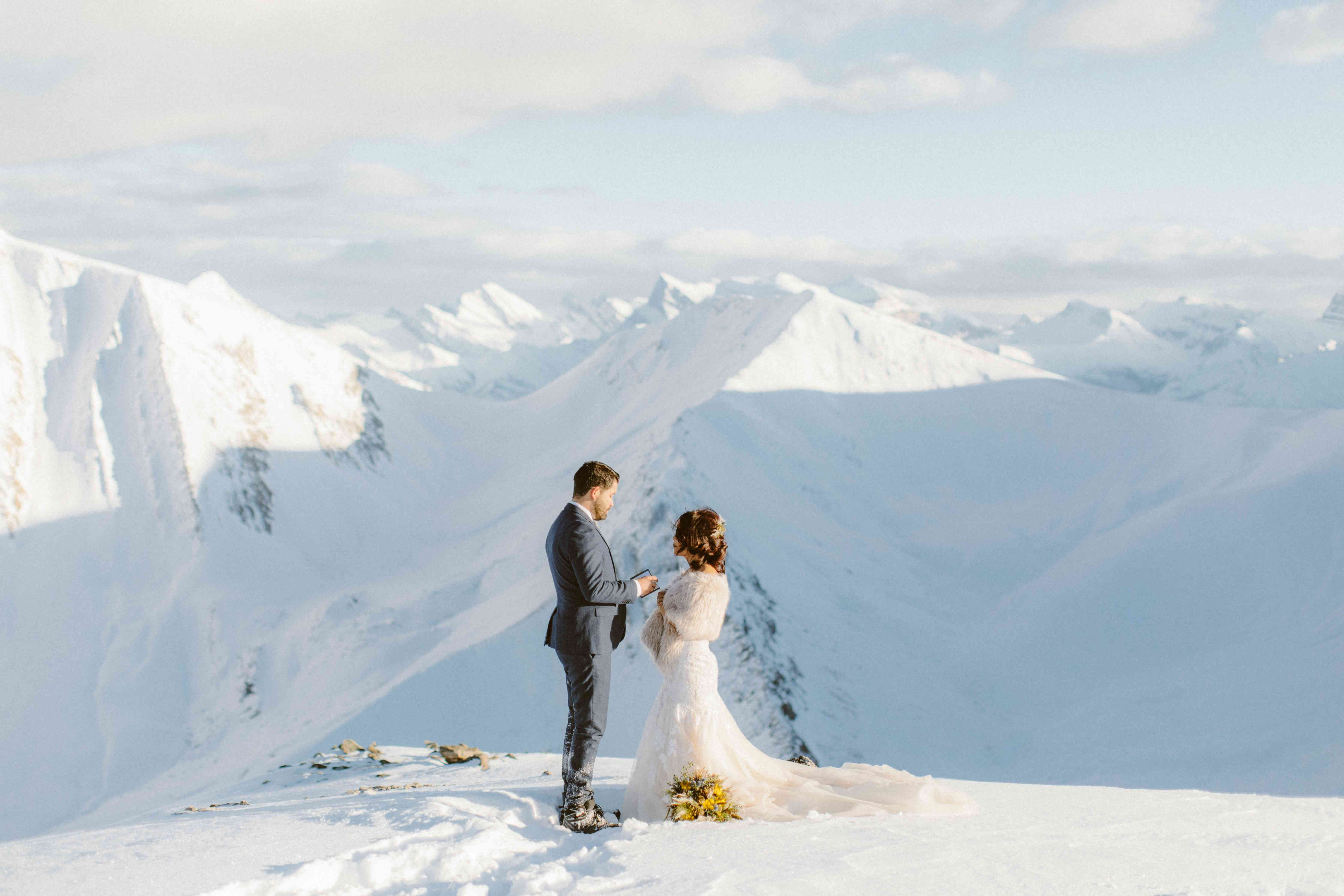 Bride and groom standing amongst glaciers