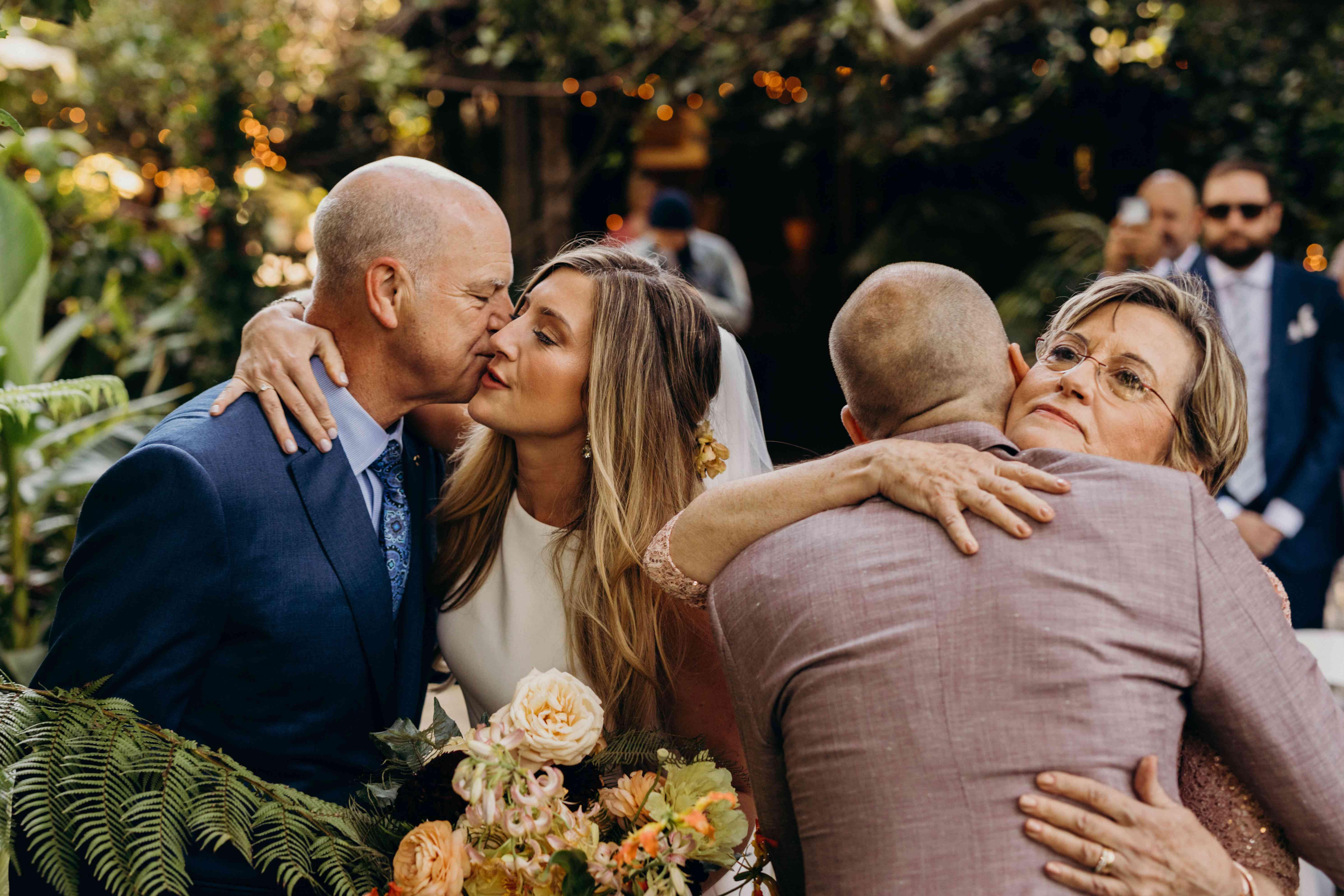 couple kissing parents