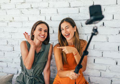 women using a selfie stick